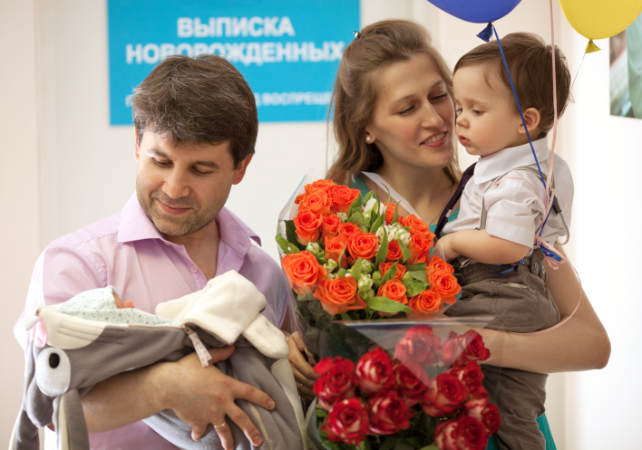 Family in the maternity hospital with newborn
